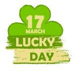 17 de marzo el día afortunado con la muestra del trébol, pone verde la bandera exhausta Imagen de archivo