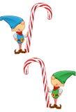 De Mascotte die van het elf - een Riet van het Suikergoed houdt Stock Fotografie