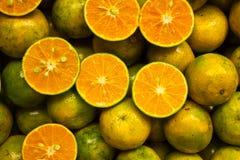 De massa van sinaasappel en was de gesneden helft Stock Afbeelding
