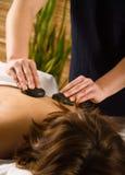 De massage van de steen stock afbeeldingen