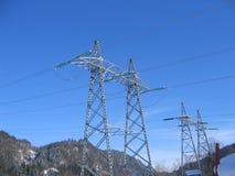 De masten van de hoogspanning Stock Foto
