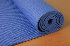 De Mat van de yoga op Sinaasappel Stock Foto