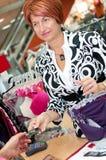 De medewerker van de winkel Stock Fotografie