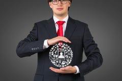 De media van de zakenmanholding pictogrammen Royalty-vrije Stock Afbeeldingen