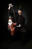 De Meester van de marionet Stock Afbeeldingen