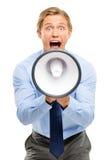 De megafoon van de zakenmanholding op witte achtergrond wordt geïsoleerd die Royalty-vrije Stock Afbeeldingen