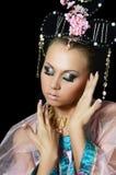 De meisje-danser in een kostuum van de Japanners Royalty-vrije Stock Foto's