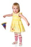 De meisjekosten met een partijhoed in een hand Royalty-vrije Stock Foto's