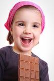 De meisjes eten chocolade Stock Foto
