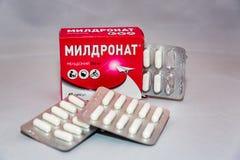 De Meldoniumdrug aan het Agentschap ` s wordt toegevoegd van de Wereldantidoping verbood lijst Russisch pak dat stock afbeelding