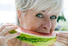 De meloen eet Stock Foto's