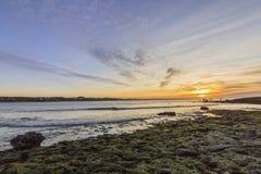 De mening van de zonsondergangatlantische oceaan bij Tamarist-strand, in Casablanca Royalty-vrije Stock Afbeelding