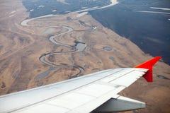 De mening van het de lenteland van vliegtuigvenster Royalty-vrije Stock Afbeeldingen