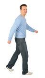 De mens in blauwe sweater gaat royalty-vrije stock afbeelding