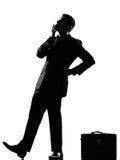 De mens die van het silhouet het peinzende omhoog looiking denkt Royalty-vrije Stock Afbeelding