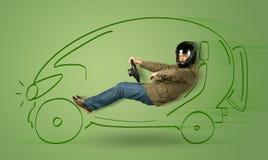 De mens drijft een eco friendy elektrische hand getrokken auto Royalty-vrije Stock Afbeeldingen
