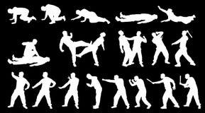 De mens en de vechtsporten van het Sihlouettegevecht Stock Foto