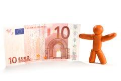 De mens en het geld van de plasticine Stock Fotografie