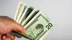 De mens geeft een handvol van geld stock afbeelding