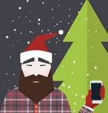 De mens gekleed als Santa Claus houdt smartphone Stock Foto's