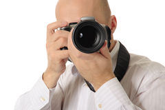 De mens houdt een camera stock fotografie