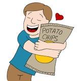 De mens houdt van Chips Stock Foto's