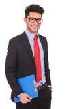 De mens met klembord & dient zak in Stock Foto