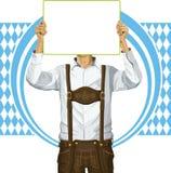 De mens met schrijft Raad op Oktoberfest Royalty-vrije Stock Afbeeldingen