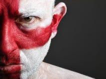 De mens met zijn gezicht schilderde met de vlag van Engeland Stock Foto