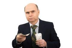 De mens overhandigt het bankbiljetgeld stock fotografie