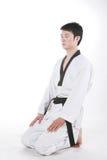 De mens speelt met taekwondo stock foto's