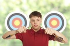 De mens splitst pijl op Stock Foto