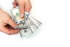 De mens telt nieuw ons dollars op wit worden geïsoleerd dat royalty-vrije stock foto's