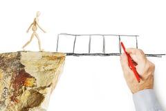 De mens trekt een brug en redt andere persoon van het vallen in de afgrond Royalty-vrije Stock Afbeeldingen
