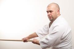 De mens van Aikido met bokken Stock Fotografie