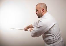 De mens van Aikido met bokken Royalty-vrije Stock Afbeelding