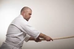 De mens van Aikido met bokken Stock Afbeelding