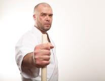 De mens van Aikido met een stok Royalty-vrije Stock Foto