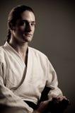 De mens van Aikido met katana (zwaard) Stock Fotografie