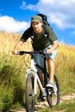 De mens van Biking stock afbeelding