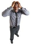 De mens van Businesss met handen op hoofd toe te schrijven aan mislukking Royalty-vrije Stock Foto's
