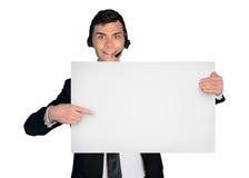 De mens van de bedrijfsmensenhulp met lege banner stock foto's