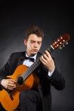 De mens van de gitaar Stock Foto's
