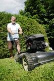 De mens van de grasmaaier Royalty-vrije Stock Foto's