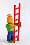 De Mens van de klei houdt Ladder Royalty-vrije Stock Afbeelding