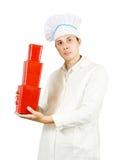 De mens van de kok met rode pakketten Stock Fotografie