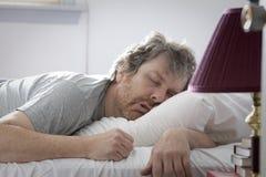 De mens van de slaap Royalty-vrije Stock Afbeelding