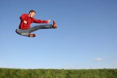 De mens van de sprong figth stock foto's