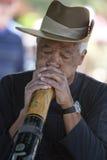 De Mens van Didgeridoo Stock Afbeeldingen