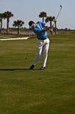 De mens van Golfing Stock Afbeelding